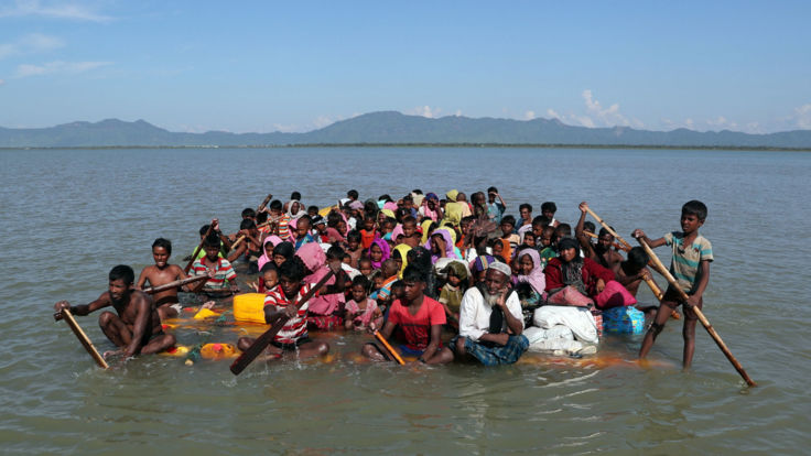 Rohingya refugees cross the Naf river with an improvised raft to reach Bangladesh at Sabrang near Teknaf