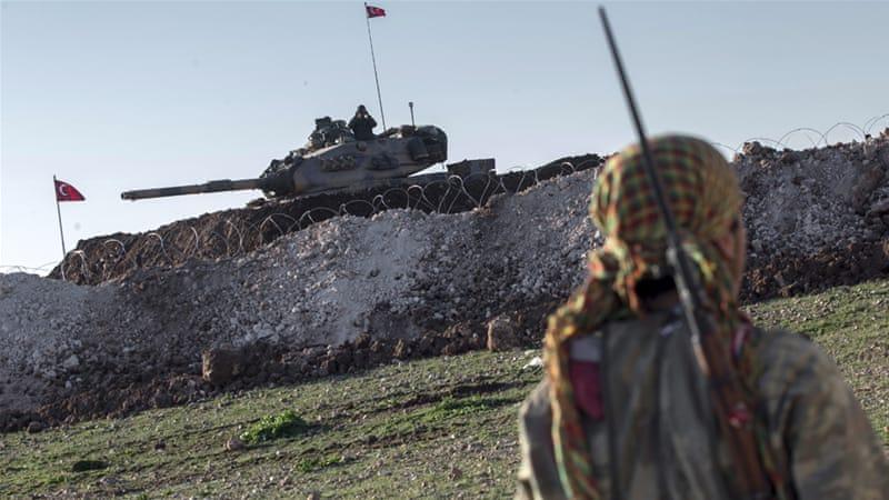 A Kurdish YPG fighter patrols near a Turkish tank in Esme village in Syria_s Aleppo province in 2015_Mursel Coban_Depo Photos _AP