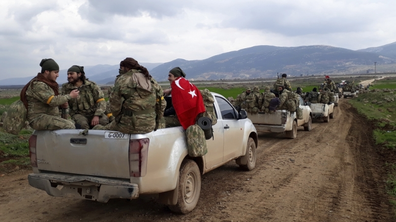 Free Syrian Army fighters head towards Afrin as part of the Turkish operation _AP