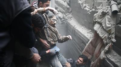 Civil defence help a man from a shelter in the besieged town of Douma in Eastern Ghouta_Bassam Khabieh_Reuters