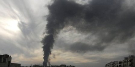 Smoke rises from Mleha suburb of Damascus