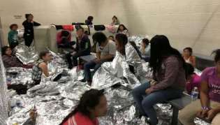 An overcrowded area holding families at a Border Patrol Centralized Processing Center is seen in McAllen