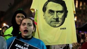 a_protester_holds_a_t-shirt_with_an_image_of_president_jair_bolsanaro_during_a_demonstration_in_sao_paulox_brazilx_august_Telesur
