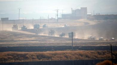 Turkish armoured vehicles on Fri drove through country roads across the border to join the Russians _Kemal Aslan_Reuters