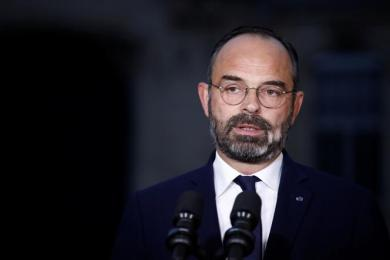 French Prime Minister Edouard Philippe delivers a statement about the pensions reform plan at the Hotel Matignon in Paris