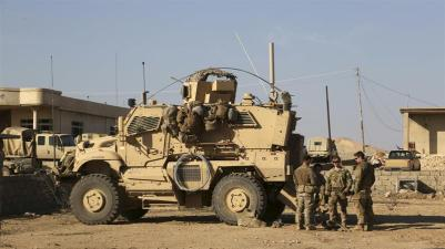 Pentagon said on Sunday it targeted Iran-linked militia group in western Iraq and eastern Syria_Khalid Mohammed_AP Photo