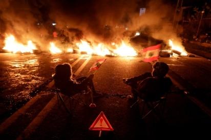 AFP _ JOSEPH EID Manifestanti