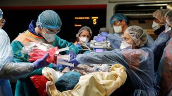 Il numero di persone a cui è stato diagnosticato il coronavirus sta raggiungendo il milione_ mettendo a dura prova i servizi sanitari in tutto il mondo_Thomas Samson _Pool via Reuters