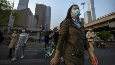 People are getting back to work in Beijing, but residents say life now is very different from what it was before the coronavirus appeared_Mark Schiefelbein_AP Photo
