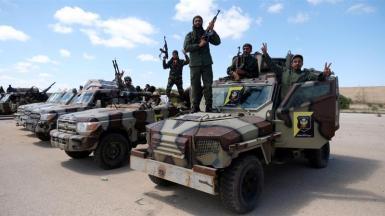Aprile 2019_ i membri dell'LNA posano per una foto mentre escono da Bengasi per rafforzare le truppe che avanzano su Tripoli_Esam Omran Al-Fetori _ Reuters