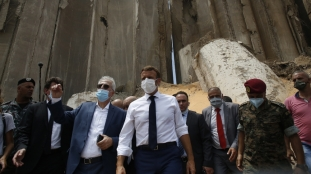 Macron visited the site of the explosion and areas of the city damaged by the massive blast _Thibault Camus_AP Photo